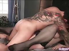 Horny tattooed dyke gets Nina off with skillful pussy licking.