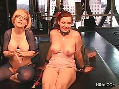 Nina takes not very big but good shaped dildo and puts condom on it to toy Nica.
