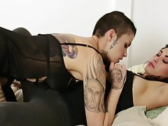 See these two brunette beauties strip down to their tattoos and piercings, and start doing the things that give each other the `O` face.